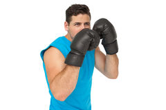 Determined male boxer focused on his training Stock Photos