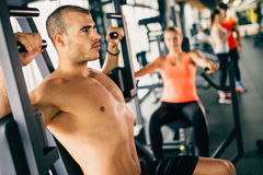 Determined male exercising in gym Stock Image