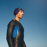 Determined male triathlete in wetsuit Royalty Free Stock Photo