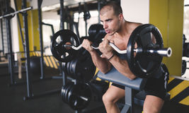 Determined male working out in gym Stock Photo