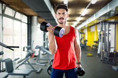 Determined male working out in gym Royalty Free Stock Image