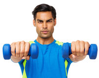 Determined Man Exercising With Dumbbells Stock Photos