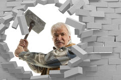 Determined man with hammer in hands Stock Image