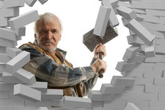 Determined man with hammer in hands Stock Photos