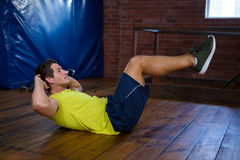 Determined man performing crunches Stock Images