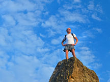 Determined man standing on mountain top Royalty Free Stock Photos