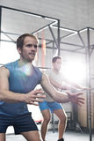 Determined men exercising at crossfit gym Royalty Free Stock Photography
