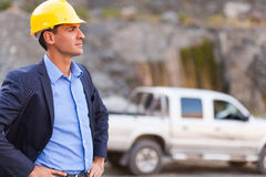 Determined mine manager. Handsome determined mine manager visit mining site Royalty Free Stock Image