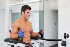 Determined muscular man doing crossfit fitness workout in gym Stock Photos