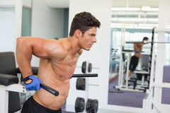 Determined muscular man doing crossfit fitness workout in gym Stock Images