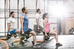 Determined people lifting kettlebells at crossfit gym royalty free stock photography