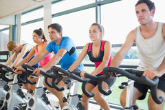 Determined people working out at spinning class Stock Photography