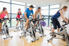 Determined people working out at spinning class Stock Image