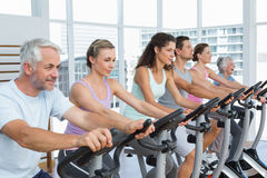 Determined people working out at spinning class Royalty Free Stock Photos