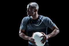 Determined rugby player holding ball Royalty Free Stock Photos