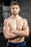 Determined shirtless man with arms crossed Stock Photo