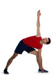 Determined sports player exercising with hand raised Stock Photography