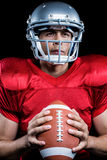 Determined sportsman holding American football Stock Photos