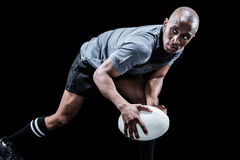 Determined sportsman looking away while playing rugby Royalty Free Stock Photography