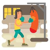 Gritty woman in boxing training. Determined, strong and active woman in a boxing training beating the punchbag Royalty Free Stock Photos