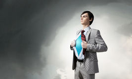 Determined super businessman Stock Image