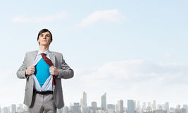 Determined super businessman stock photo