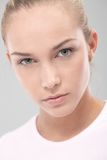 Determined teenager beauty. Closeup portrait of determined teenager beauty looking severe at camera Stock Image