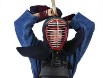 Determined to attack. Woman in kendo (japanese fencing) helmet determined to attack Royalty Free Stock Photos
