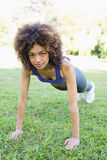 Determined woman doing push ups in park Royalty Free Stock Image