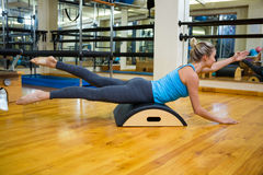 Determined woman exercising on arc barrel Royalty Free Stock Photo