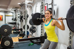 Determined woman lifting a barbell Stock Photography
