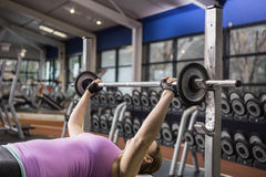 Determined woman lifting barbell Stock Images