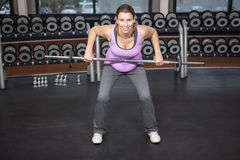 Determined woman lifting barbell Royalty Free Stock Images