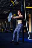 Determined woman lifting barbells Royalty Free Stock Photography