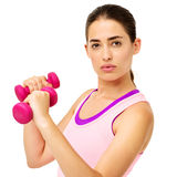 Determined Woman Lifting Dumbbells Royalty Free Stock Photos
