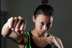 Determined woman practicing boxing in fitness studio royalty free stock photo