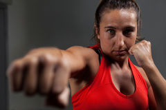 Determined woman practicing boxing in fitness studio royalty free stock images