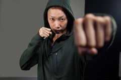 Determined woman practicing boxing in fitness studio royalty free stock photography