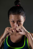 Determined woman practicing boxing in fitness studio stock image