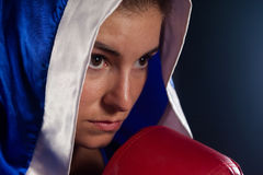Determined woman wearing boxing robe Royalty Free Stock Image