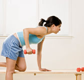 Determined woman working out with dumbbells royalty free stock photos