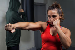 Determined women practicing boxing royalty free stock image