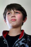 Determined Young Dark Haired Boy Stock Images