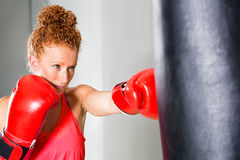 Determined young female boxer Stock Photo