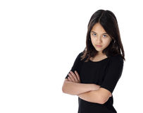 A Determined Young Girl Glares. An angry young girl is upset and wants her way immediately royalty free stock image