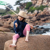 Determined young kid playing fishing with energy for success Royalty Free Stock Photography