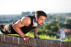 Determined young man doing push-ups. stock image