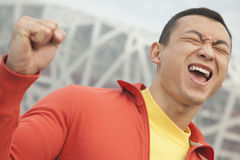 Determined young man with fist in the air, close-up, Beijing Royalty Free Stock Images