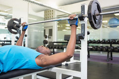 Determined young man lifting barbell in gym Royalty Free Stock Photos