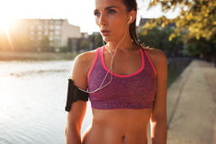 Determined young sportswoman training outdoors Stock Image